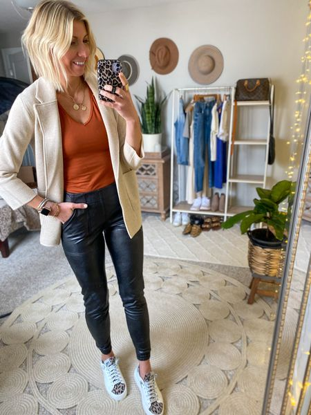 How to style the spanx faux leather joggers…w/ a basic tee, cardigan + sneakers.  These joggers run true to size. A great time to get them at a huge discount.   #LTKunder100 #LTKstyletip #LTKsalealert