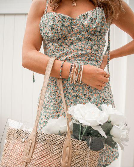 Floral ruched dress ($13) colorful bracelets and a clear tote ($20)! Summer ready! ☀️  #ltkseasonal #competition   #LTKunder50 #LTKSeasonal #LTKunder100