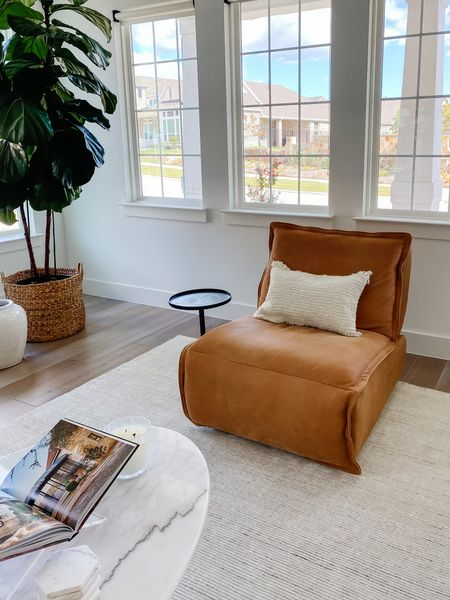 Fall decor for our living room by changing out the pillows to include fall texture. Love how cozy this is on our leather recliner. Also linking my entryway rug, martini table, coffee table and other coffee table decor.  #LTKhome #LTKsalealert #LTKstyletip