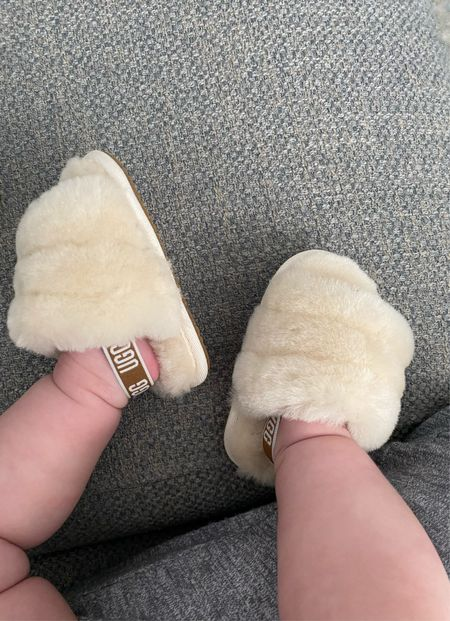Is there anything cuter than baby feet? I got my baby girl these genuine shearling slide slippers from Ugg and I just can't. Even. Deal. With how cute they are!! They come in multiple colors, and I've also linked to a similar pair of fur sandals that's under $20.   #LTKbaby
