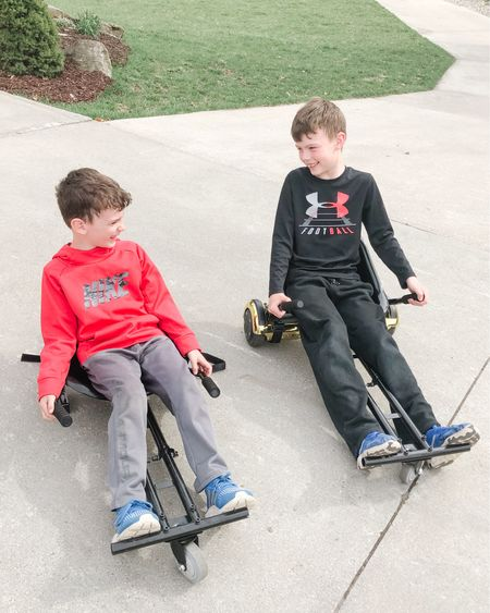 My kids love their Hoverboards and then for Christmas they got these Hoverboard attachments to turn them into go-karts. They strap on with Velcro straps and then the handles become the  controllers. Super quick to put on and take off. They love cruising our quiet street with them and of course their helmets.   http://liketk.it/2NQjZ #liketkit @liketoknow.it #LTKfamily #LTKhome Screenshot this pic to get shoppable product details with the LIKEtoKNOW.it shopping app