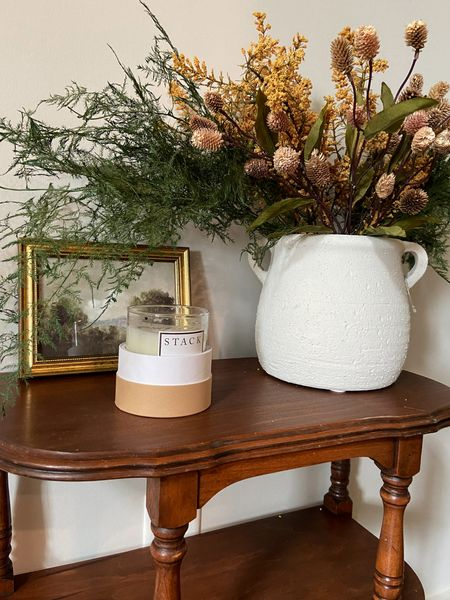 Fall is officially here! Styled this little antique entryway table with this terracotta pot and some faux fall florals and stems. I am in love with my new landscape print from Hannah Winters art. The gold frame is only $27! Great layering piece for your fall entryway or kitchen!   #LTKSeasonal #LTKhome #LTKHoliday