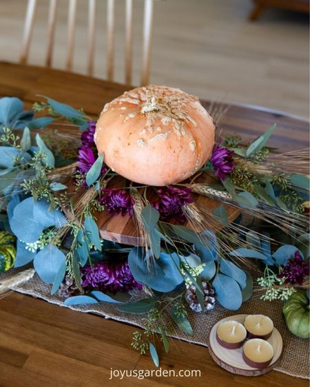 Make your own beautiful Thanksgiving centerpiece with a few new decor items! This cake stand, eucalyptus garland, and burlap runner make the perfect base for a DIY Thanksgiving centerpiece. Thanksgiving decor,  holiday centerpiece, DIY centerpiece, pumpkin decor, fall centerpiece  #LTKSeasonal #LTKhome #LTKHoliday