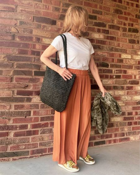 I love a little glam for day! These Ann Taylor palazzo pants in cognac amber can be dressed down with a basic white t-shirt and sneakers. I'm wearing gold metallic Adidas Stan Smiths, a camo print jacket and a black straw tote bag. This look is perfect for busy days and I won't mind running into someone I know.   #LTKshoecrush #LTKunder50 #LTKstyletip