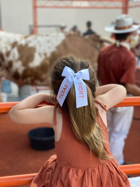 This little Longhorn is hooked on BEVO 🤘🐮🧡 use code RealMomRealTired at checkout for 10% off this adorable Texas Fight Bow in size medium 🎀 #burntorange #hookem   #LTKfamily #LTKbaby #LTKkids