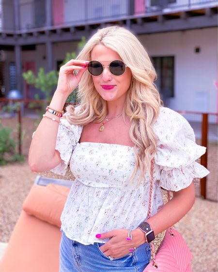 White floral puff sleeve blouse size L - could have sized down - code KIM15 for 15% off.  Brown sunglasses - code purposeinthepink for 15% off. Pink quilted purse  Distressed mom jeans.  Gold initial necklace  LV Apple Watch band  Summer outfit, summer top, vacation outfit, vacation top date night outfit http://liketk.it/3gYLT #liketkit @liketoknow.it #LTKDay #LTKunder50 #LTKstyletip