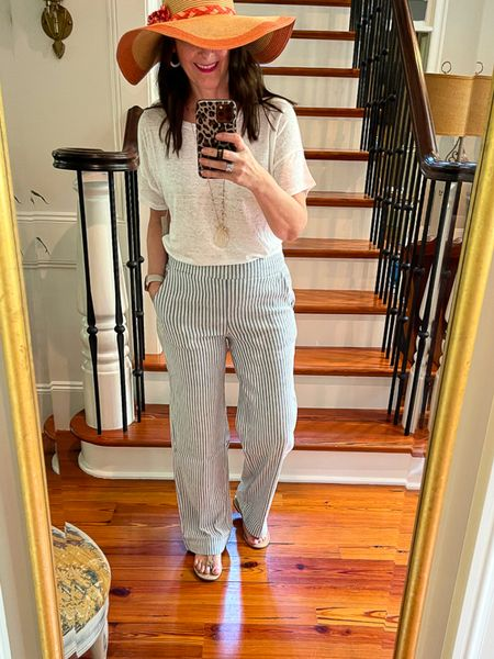 The perfect outfit to dress up or down for a summer day of shopping to outdoor dining! Chico's is amazing! These pull on blue and white striped pants are so comfortable with the white linen shirt.    You can instantly shop my looks by following me on the LIKEtoKNOW.it shopping app http://liketk.it/3g1MY #liketkit @liketoknow.it #LTKsalealert #LTKstyletip #LTKhome