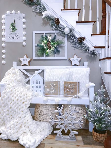"""http://liketk.it/33HGV #liketkit @liketoknow.it   """"Meet me under the Mistletoe"""" Christmas bench farmhouse entryway design  ... winter whites, a farmhouse bench, soft knit throws, snowball garland, and twinkling lights make for the perfect place to meet your Christmas love under the mistletoe 🤍  White bench, farmhouse bench, entryway, knit blankets, mistletoe, stairway designs, farmhouse Christmas, Christmas bench designs"""