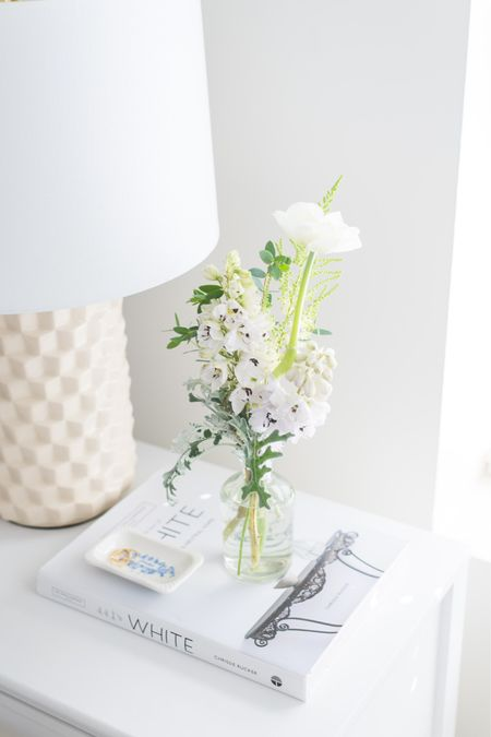 WHAT'S ON YOUR BEDSIDE TABLE?  Three things I almost always have on mine are: 🤍 Books 🤍 Flowers 🤍 Jewelry Dish  I really try to keep it clutter free so that I start and end the day with a tidy view. Choosing a table that has a drawer for storage is always a good idea 🙌  Have a wonderful day!  Flowers: @vivioflowers Photo: @fridayevephoto    #LTKhome #LTKunder50
