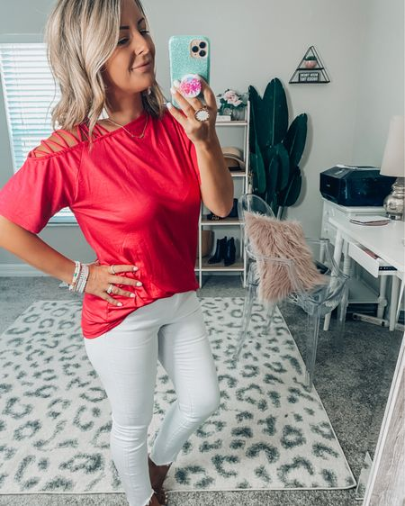 This hot pink shoulder cut out t-shirt is the cutest! Available in a coral color also! Sign up for text notification for 15% off! http://liketk.it/3fTGR #liketkit @liketoknow.it #LTKunder50 #LTKstyletip #ltkspring #ltksummer