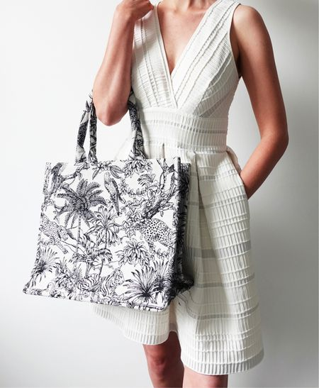 I've wanted a Dior book tote bag for  second now, but I'm not sure how much I'd use the bag with no other option than top handles... in walks H&M with this high street dupe!  This printed tote was only £24.99 (a tiny fraction of the Dior tote) and has enabled me to see how much I like this style of bag. Check out my latest video on YouTube for 6 of the best high street dupes of designer bags & save THOUSANDS.   #Diorbag #ToteBag #summerdress #whitedress  #LTKstyletip #LTKDay #LTKSeasonal