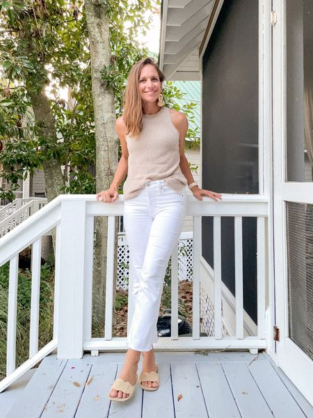 Love this summer sweater tank! Size up 1 size, I'm wearing the medium. Raffia sandals have been my go-to and they're tts. Best white denim around and they're tts. Earrings are old but linking similar options!