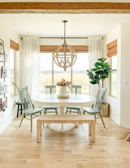 Dining room sources linked here. Wooden bench from Walmart. Chandelier is from Arhaus. Fiddle tree is from World Market. The green chairs are from Anthropologie.