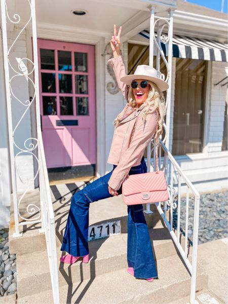 Flare jeans - runs large so size down Blush studded leather jacket size M  Cream fedora  Pink quilted designer inspired purse - comes in other colors White crop tank  Gold bracelet stack Pink booties TTS  Brown Sunglasses  Western outfit, concert outfit, fall outfit, trendy outfit   #LTKshoecrush #LTKstyletip #LTKunder100
