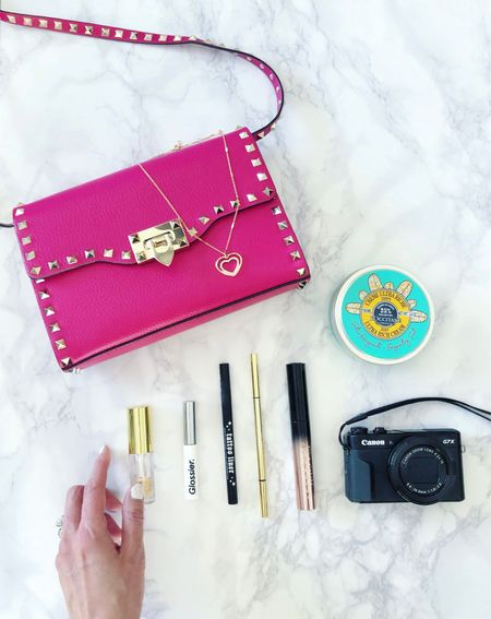Current faves... Love a bag to add a pop of color to my look. Linked this same bag in a gorgeous powder blue and a similar bag in the same shade of bright pink. 💕💕  Lately, I've been wearing less makeup but eye makeup and skincare is still essential for every day! Linked in this post are some current beauty faves: - Lip oil is hydrating and feels luxurious.  - Brow gel: versatile color that wears naturally - Liquid eyeliner  - Brow pencil  - Mascara: for dramatic volume,  - Body lotion that's hydrating and a necessity this time of year!  And last but not least, this camera is the perfect blend of compact and high quality. Great for video, now I just have to make some! 😂 😉  #LTKunder100 #LTKbeauty #LTKunder50