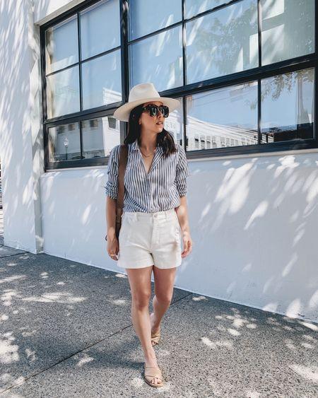 Everlane summer essentials. Classic striped bottom down.   Shirt - Everlane xs Shorts - Everlane 0 Sandals - Everlane 5 Hat - Janessa Leone Aisley  Sunglasses - Anine Bing (old)  http://liketk.it/3hMc0 @liketoknow.it #liketkit #LTKunder100 #LTKshoecrush