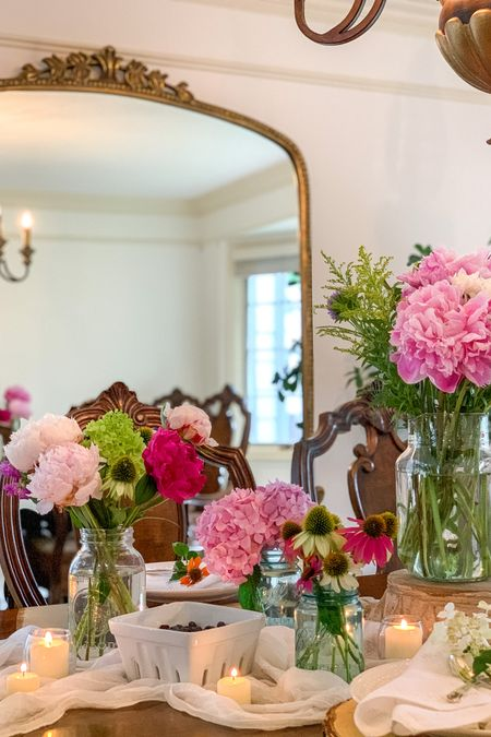 Create a beautiful Floral inspired tablescape for your next Gathering! Just grab your favorite florals and display them in mason jars and add some votive candles. Pair your florals with wood slice chargers and muslin fabric for a romantic country chic feel. 😌🌸  Mason Jars, Muslin Runner, Gleaming Primrose Mirror  🌸French Country Decor, French Farmhouse style decor, Romantic Cottage Style 🌸   Follow me on the LIKEtoKNOW.it shopping app to get the product details for these finds and others 🙌   http://liketk.it/3jQLT #liketkit @liketoknow.it.home #LTKhome #LTKstyletip #LTKunder50 @liketoknow.it