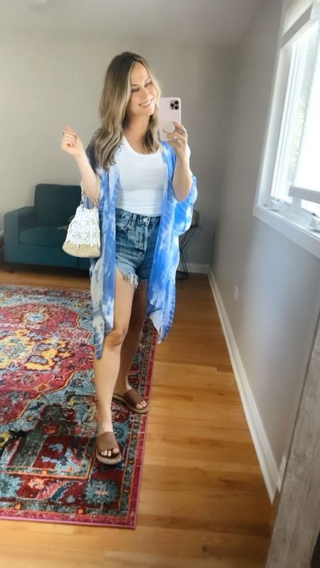4th of July outfit ideas!! These jean shorts are back in stock and only $15! This white tank top is under $10 and my tie dye kimono is only $12!!! Also linked this little purse it's an amazon find and these sandals!   #LTKitbag #LTKshoecrush #LTKstyletip