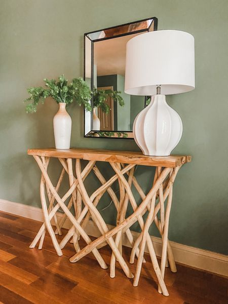 Add some interest with this tree branch console table.  #consoletable #twigdecor #woodbranches #consolestyle #accentfurniture #homedecor   #LTKhome