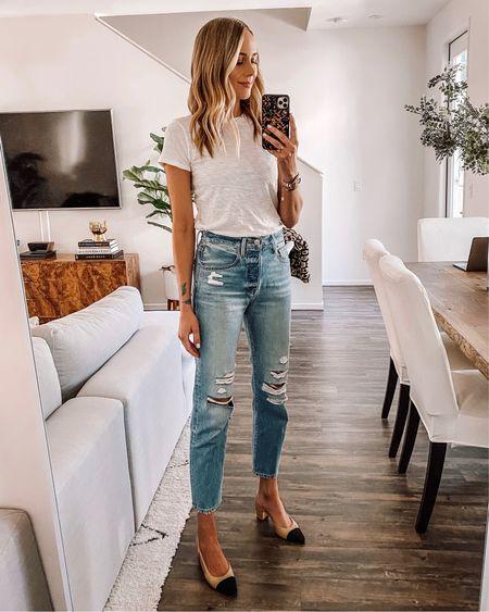 Fashion Jackson wearing white T-shirt (small/tts). Ripped jeans (25/tts), similar Chanel slingbacks http://liketk.it/2LJx7 #liketkit @liketoknow.it #LTKstyletip #LTKspring #LTKunder100 #LTKsalealert #LTKunder50