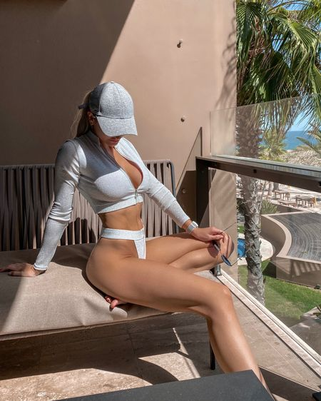 This metallic bikini is so unique. The long sleeve top as a full zip up front perfect if trying to protect your chest from a sunburn. This swimsuit is from Meshki and currently on sale for under $100 total. They have lots of fun unique swimwear for any beach vacation. http://liketk.it/3bbtb #liketkit @liketoknow.it