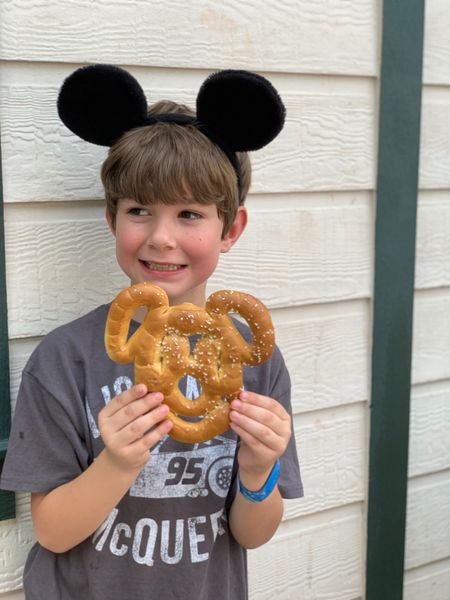 For those of us who aren't gluten free, a #mickeyshapedpretzel is a #crowdfavorite . This one we found after leaving #lightningmcqueensracingacademy at #hollywoodstudios .  Speaking of Disney's Hollywood Studios, have you been recently? Last week they finally opened up the new tram area with a lot more tables for bag check! 🙌🏽   http://liketk.it/2BUsl #liketkit @liketoknow.it   What is your favorite Disney Park snack?