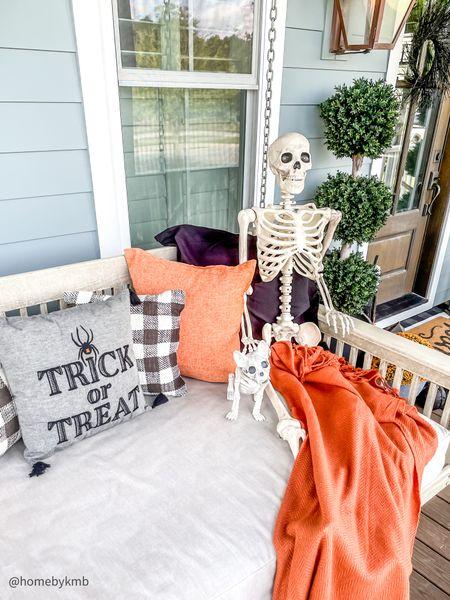 Halloween front porch   porch swing   Halloween decor   #LTKhome #LTKSeasonal