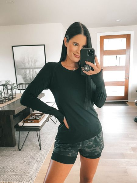 Spanx just launched new Get moving athletic shorts! This is a great way to try out the biker shirt trend if you were unsure before! I wear a size small. My long sleeve workout top is also from spanx and I'm wearing a small! Use code DTKxSPANX for 10% off your entire order!   #LTKstyletip #LTKsalealert #LTKfit
