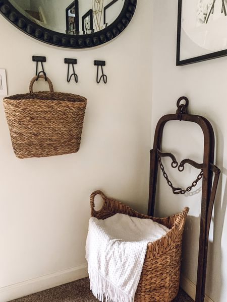 A little view of our small entryway. I just picked up this hanging basket to hold my son's masks so he can easily grab one before heading out the door to the school bus! Such a cute way to hide all the clutter!  #LTKSeasonal #LTKhome #LTKunder50
