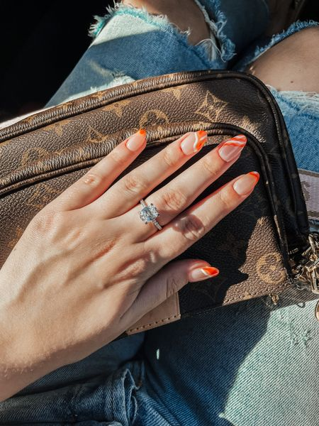New nails 🧡 found this beautiful 3 ct CZ ring on Amazon and am obsessed! Joel and I have been talking about updating my engagement ring so I've been trying different rings shapes, sizes and styles out to see what I like. This would also make for a great vacation ring if you don't want to wear you're real one out! And it's sterling silver so it's durable!   #LTKunder50 #LTKwedding #LTKstyletip