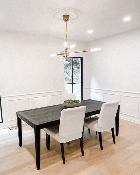Love this Kelly wearstler light for our dining room! Table is RH and chairs are ikea #homedecor #diningroom   #LTKhome #LTKstyletip