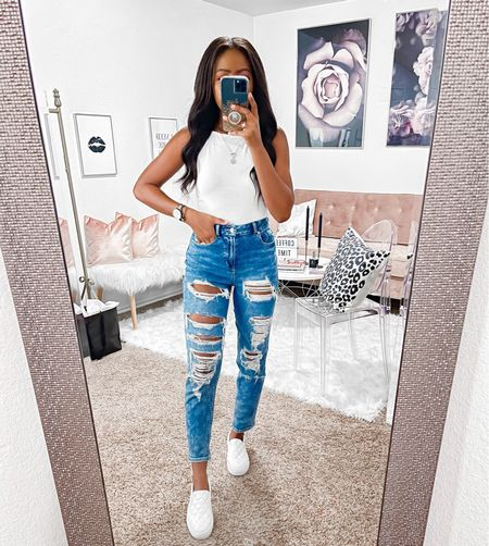"""Wearing a small in the bodysuit which has some stretch to it. It has a halter style neckline in the front and back. I'm wearing a 00 in the high rise stretch mom jeans. I'm 5'4"""" and they sit about one inch above my belly button.    #LTKsalealert #LTKstyletip #LTKunder50"""
