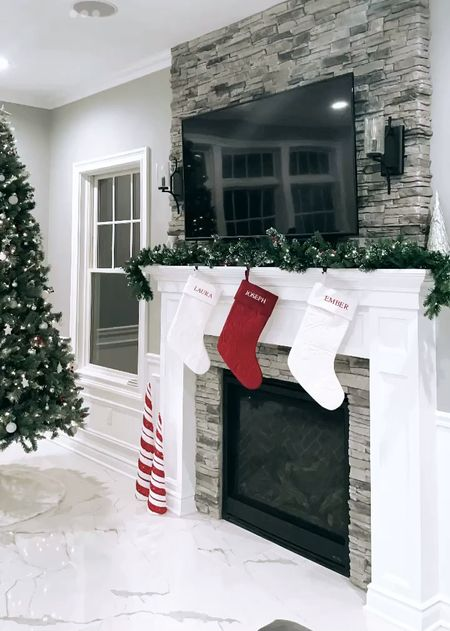 Our living room holiday decor from last year in case anyone is shopping for Christmas decorations. I loved our pre-lit fake tree, personalized stockings, evergreen garland, and more.   #LTKHoliday #LTKSeasonal #LTKhome