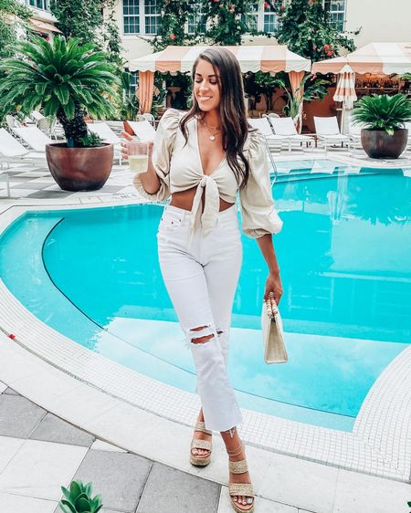Beige tie front puff sleeve top, distressed white mom jeans, and raffia heels by Matisse.  White pants  Tie front top Neutral outfit ideas  White after Labor Day Vacation outfit  Miami outfit   #LTKunder100 #LTKunder50 #LTKtravel