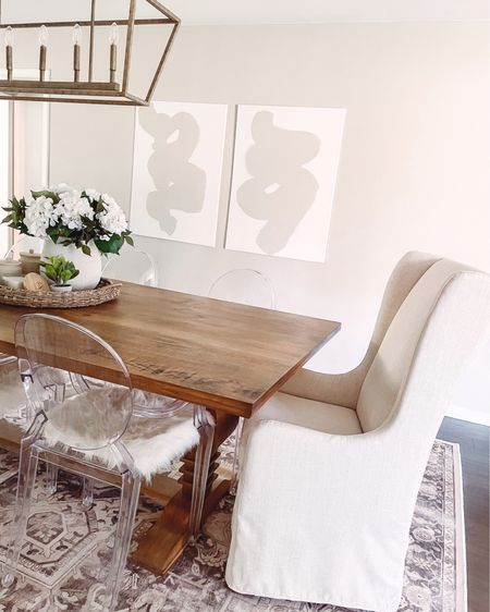 Switched out my upholstered end chairs for these gorgeous @studiomcgee for @target slipcovered chairs and I. Am. Obsessed! 😍 It changes the whole look + feel of our dining room (in my opinion). Though my husband says he can't tell a difference...he just doesn't want to admit that he also thinks they look soo much better. 🤣 http://liketk.it/3f8t5 #liketkit @liketoknow.it #LTKhome