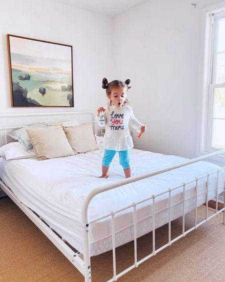 White metal platform bed and sisal and jute rug  #LTKfamily #LTKhome #LTKkids