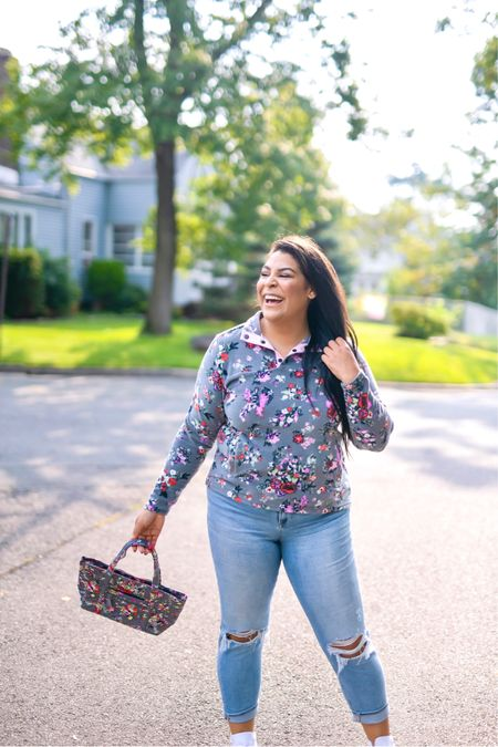 """5% of profits of Vera Bradley new print in Hope Blooms goes to breast cancer research! Use code """"queencarlene"""" for an additional 10% off   Sweatshirt (L), jeans are seven (31, TTS), & shoes are converse (size down 1.5 sizes)  Vera Bradley collection, travel essentials, #verabradley, travel must-haves, backpacks, floral bags, Vera Bradley travel, casual style, midsize, mid size, aerie, light denim jeans, converse, high rise denim, size 12, size 14, high tops, fall fashion, fleece, sherpa   #LTKGiftGuide #LTKunder100 #LTKstyletip"""