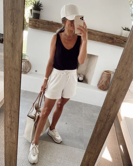 Black tank + white lounge shorts for a casual summer outfit… trainer sneakers are very comfortable as well //   #LTKunder50 #LTKstyletip