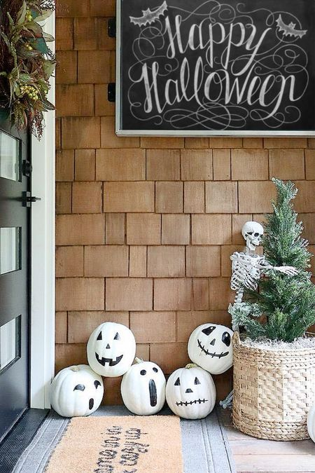 Happy Halloween friends!  Our porch has been decorated for the holiday and we are ready to hand out candy!  Come on in and cozy up!   #LTKhome #LTKSeasonal #LTKHoliday