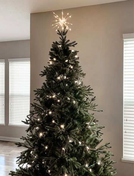 """Simply obsessed with our realistic artificial Christmas tree from Balsam Hill. The """"true needle"""" foliage gives us the look of a real tree without the annoying upkeep 🎄 Christmas Tree // Modern Tree Topper // Balsam Hill // Realistic Artificial Christmas Tree  #LTKfamily #LTKhome #StayHomeWithLTK"""