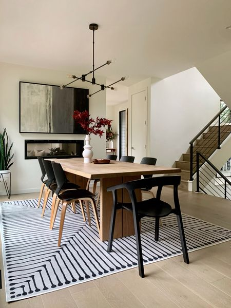 Modern dining room rug with subtle fall decor