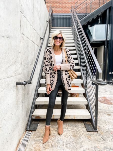 This cute printed sweater is perfect for fall! Loverly Grey has paired this with a legging.