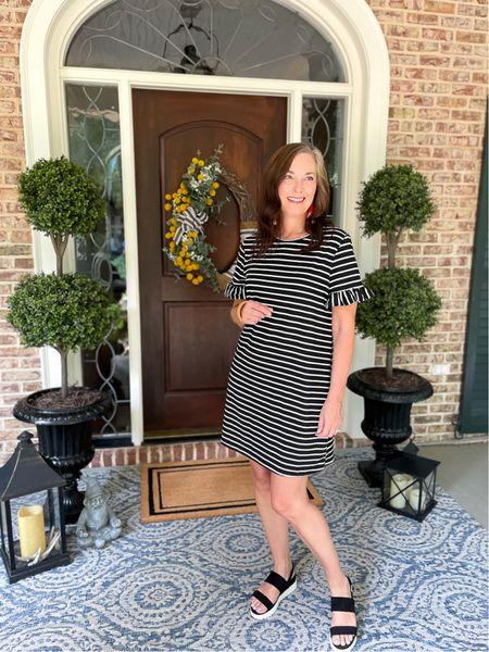 Fabulous black and white striped knit dress perfect for 3 seasons! Amazing faux topiaries for the front porch with blue and white rug.   #LTKstyletip #LTKhome #LTKunder50
