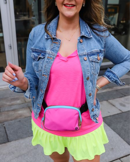 All the 90s trend going into fall. Including this neon take on a tennis skirt, a gorgeous neon pink ruffle tank, my fav jean jacket, and a belt bag. Everything fit TTS except the tank—size up on that one.   Lilly Pulitzer // midsize // latest trends //affordable outfit // neon for fall // fall transition   #LTKunder100 #LTKbacktoschool #LTKstyletip