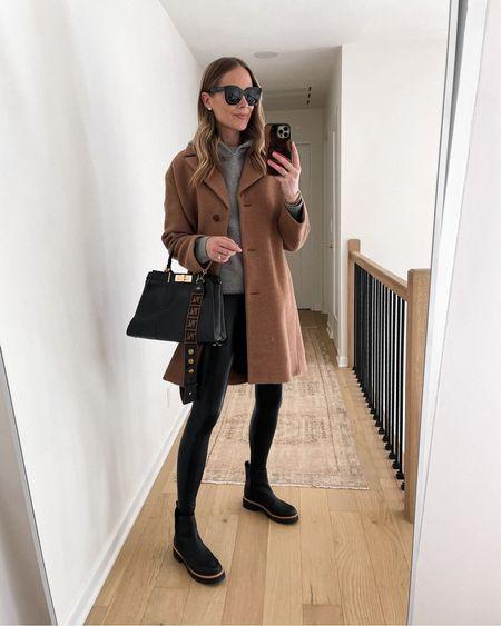 Camel coat, hoodie sweatshirt, faux leather leggings, black boots, Fendi handbag #falloutfits #camelcoat #boots   #LTKsalealert #LTKshoecrush #LTKstyletip