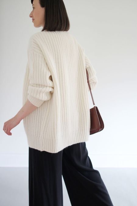 This Alpaca Cocoon Cardigan is like wearing a cloud. I suggest sizing down.  Use LEE15 for 15% Off any time.