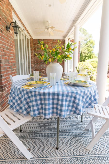 Outdoor dining space with a simple table and chairs! Tablecloth, rug, lemon branches, and more are also linked. (home decor ideas, porch, patio)  #LTKunder50 #LTKhome #LTKunder100
