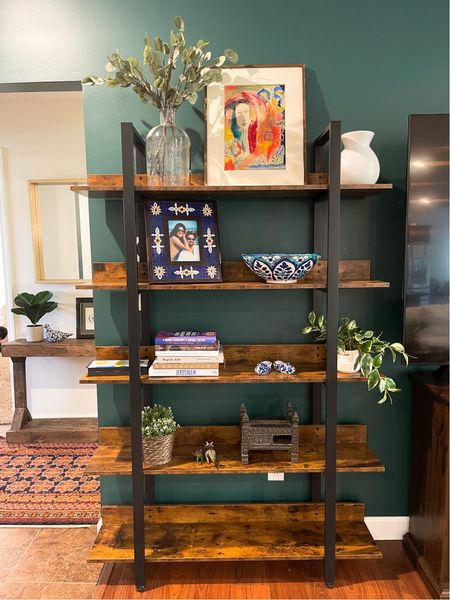 Our living room book shelves are both from Walmart. They're the perfect size and have that industrial look. Works great for storage too.   #LTKhome #LTKstyletip #LTKfamily