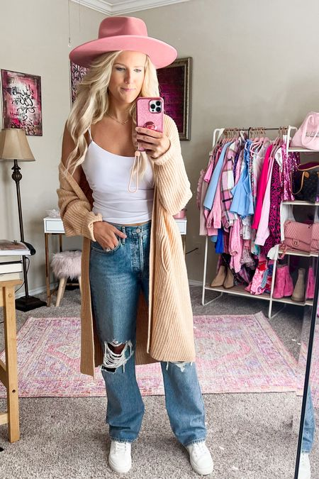 Target camel cardigan size small  Pink crop tank under $20 size M  Target gold hoops under $10  Pink fedora  White sneakers on sale for $40  Straight 90's jeans - size 27, could have gone down one more. So size down in this style! Splurge worthy denim jeans and so comfortable!   Fall casual outfit, casual fall outfit, travel outfit  #LTKstyletip #LTKunder50 #LTKsalealert