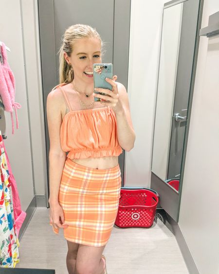 Target try-on. Peach orange ruched elastic buble top with ties, orange plaid mini skirt with slit. Ties are adjustable on top, skirt fits mostly TTS. Size up if in between sizes. I am wearing a 4. http://liketk.it/3gMir @liketoknow.it #liketkit #LTKstyletip #LTKunder50 #LTKunder100